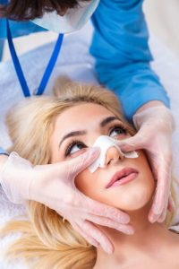 surgeon giving Rhinoplasty Recovery Tips