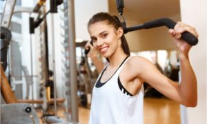 The woman is a beginner for lats exercises.