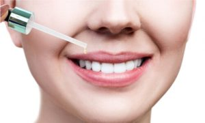 Applying essential oils for your oral health issues.