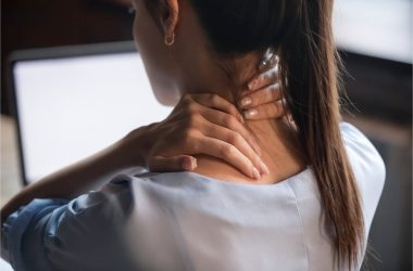 The woman suffers from neck pain.