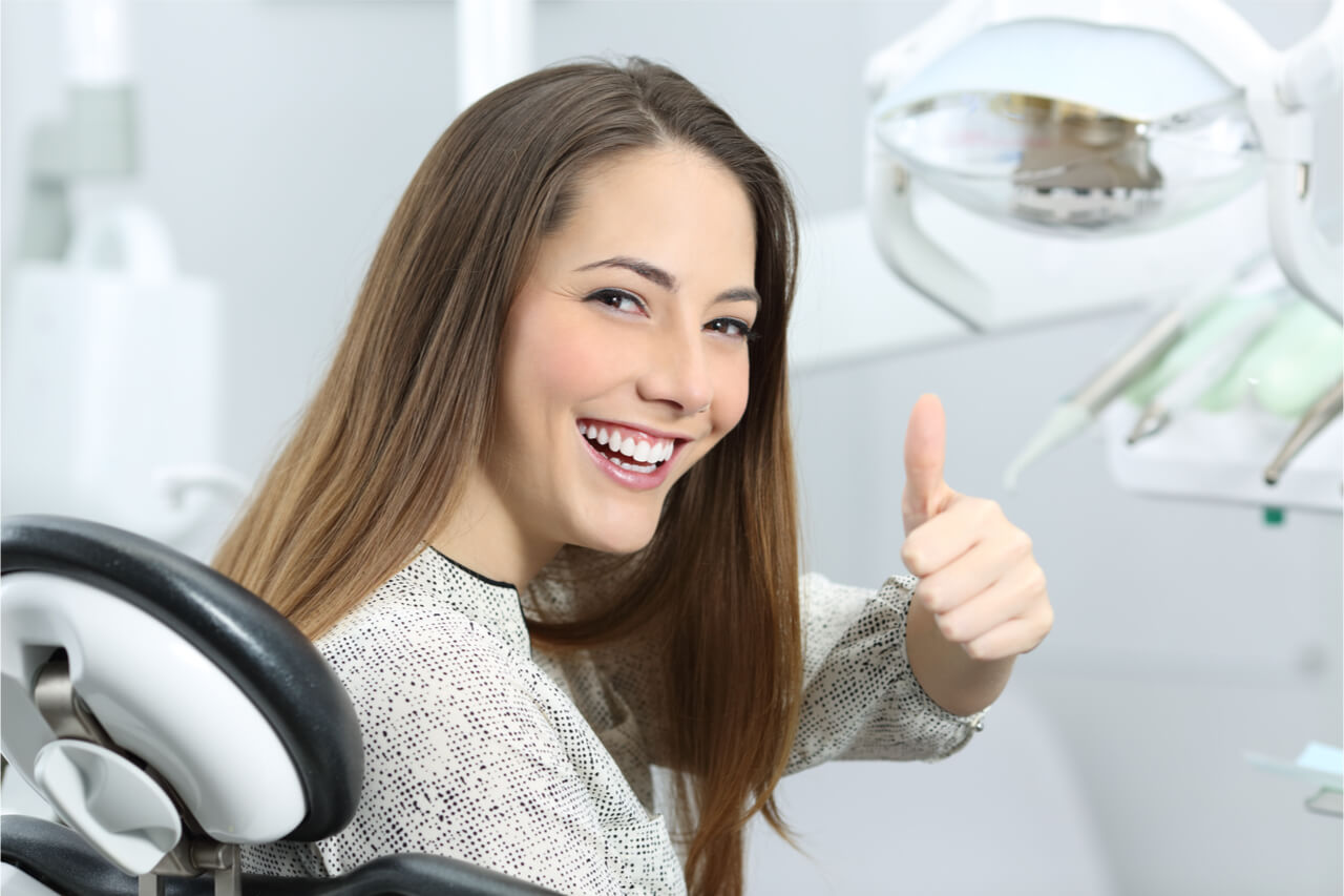 The woman visits her dentist regularly.