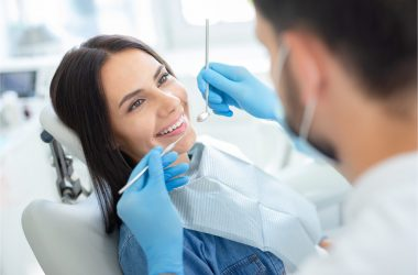 The woman visits her dentist for a dental checkup.